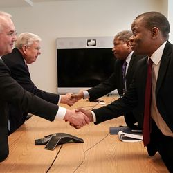 Elder Jack N. Gerard, left, greets Alexander Temitope, senior adviser, Office of the President of the General Assembly of the United Nations 74th Session, in New York City on Friday, Nov. 15, 2019. President M. Russell Ballard, second from left, acting president of the Quorum of the Twelve Apostles of The Church of Jesus Christ of Latter-day Saints, greets Jerobeam Shaanika, Deputy Chief de Cabinet, office of the President of the General Assembly of the United Nations 74th Session.