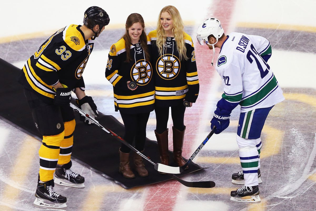 Lexie and Brianna Laing, a pair of pucks, and a couple of hockey players (captains Zdeno Chara and Daniel Sedin)