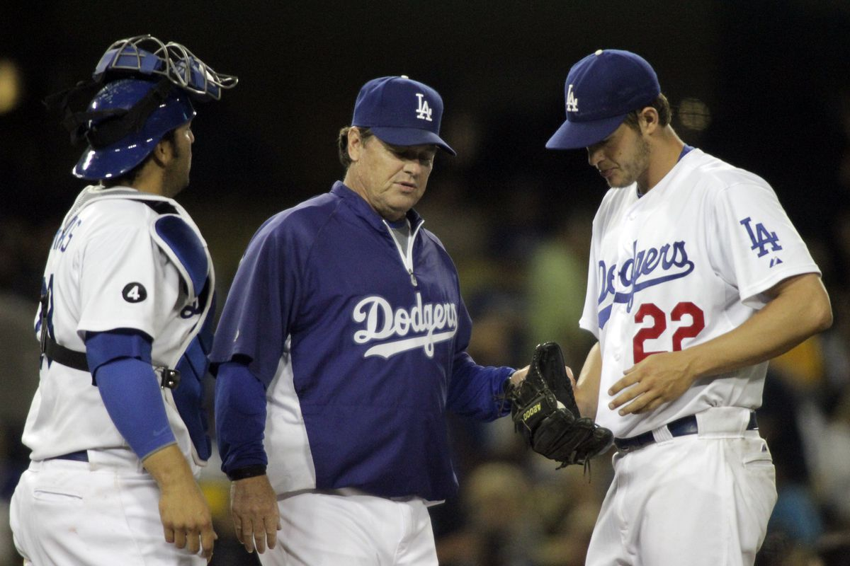 Los Angeles Dodgers pitching coach Rick Honeycutt (center) tries to calm down pitcher Clayton Kersh