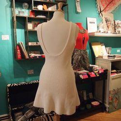 The cotton knit dress has a sexy scoop back and a flirty fit. Ooh la la!