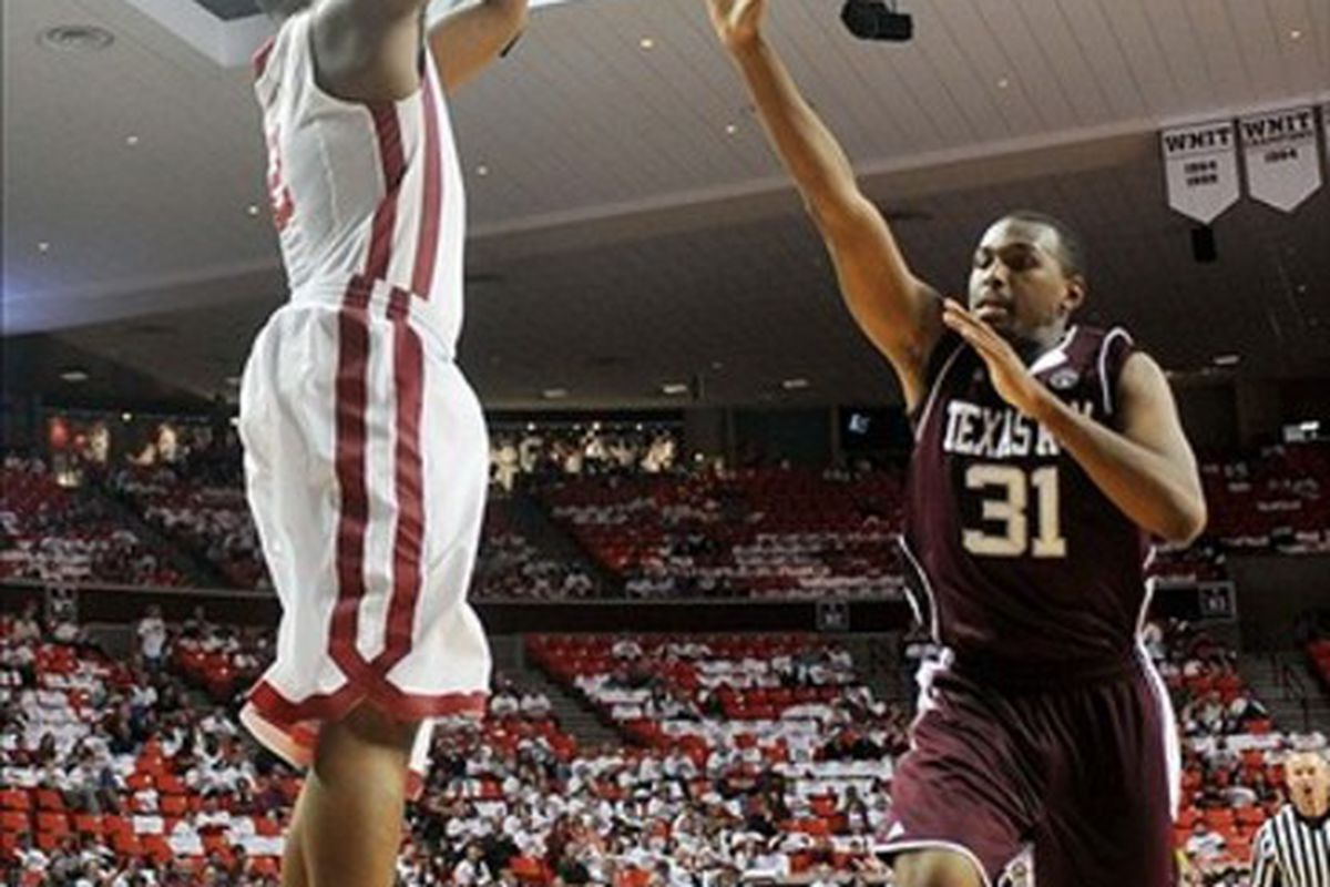 Mar 3, 2012; Norman, OK, USA; Oklahoma Sooners guard Steven Pledger (2) takes a shot against Texas A&M Aggies guard Elston Turner (31) during the second half at the Lloyd Noble Center. Mandatory Credit: Mark D. Smith-US PRESSWIRE