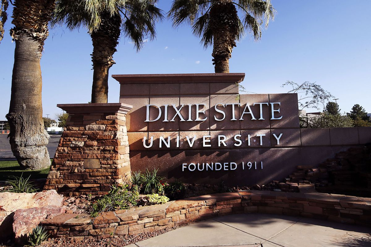 Palm trees flank an entrance to Dixie State University in St. George.
