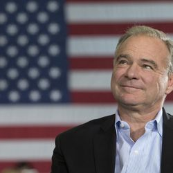 Democratic vice presidential candidate Sen. Tim Kaine, D-Virginia, listens as Democratic presidential candidate Hillary Clinton speaks during a campaign event at the Taylor Allderdice High School Saturday, Oct. 22, 2016, in Pittsburgh.