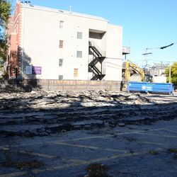 1:13 p.m. Pavement being broken up, in the broadcast lot -