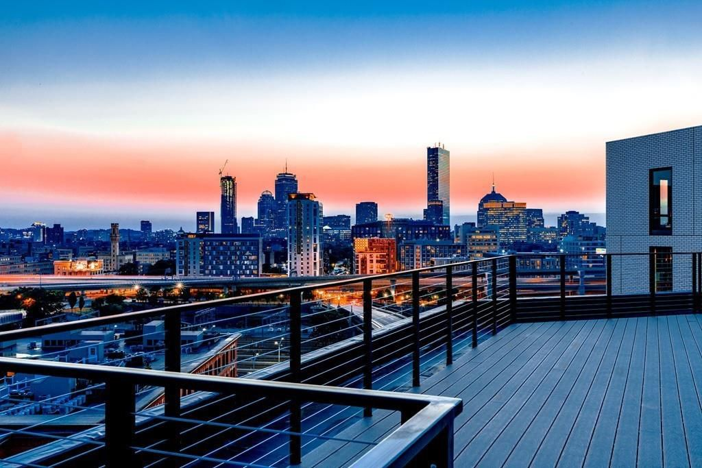 An expansive, empty deck with a city skyline in the background.