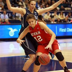Utah's Emily Potter dribbles around BYU's Jennifer Hamson during a women's basketball game at the Marriott Center in Provo on Saturday, Dec. 14, 2013. Utah won in double overtime 82-74.