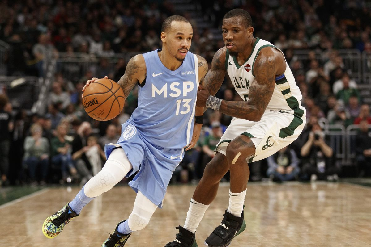Minnesota Timberwolves guard Shabazz Napier drives for the basket against Milwaukee Bucks guard Eric Bledsoe during the third quarter at Fiserv Forum.