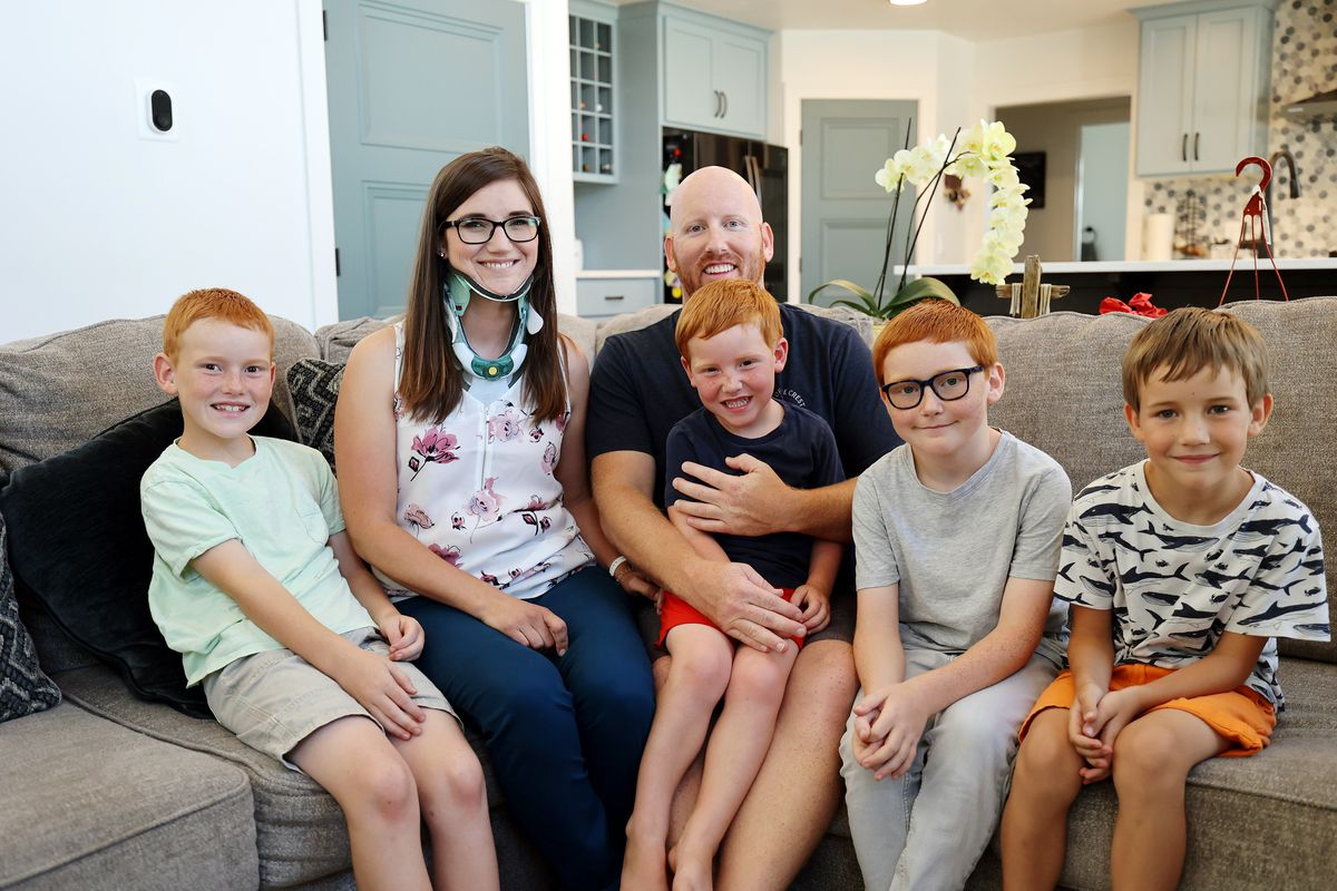 Brooke Andersen, second from left, poses for a photo with husband Tevor and sons Bridger, Graysen, Kamden and Pierce at their home in Provo on Wednesday, July 7, 2021. Brooke Andersen's spinal fusion surgery was delayed because of COVID-19 closures, but she finally made it to Spain during its brief opening window to have it. Now she can walk again, but she's still facing a lifetime of deterioration from her condition.