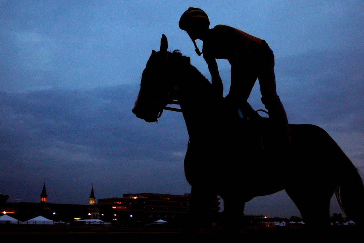 LOUISVILLE, KY - APRIL 30: A horse and rider train in front of the twin spires during morning workouts prior to the Kentucky Derby on April 30, 2009 at Churchill Downs in Louisville, Kentucky. (Photo by Jamie Squire/Getty Images)