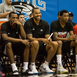 Rasheed Wallace smiles from the bench.
