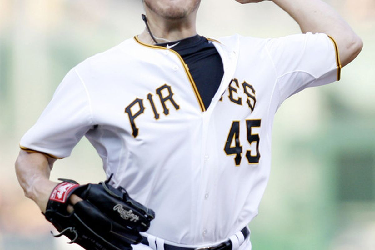June 20, 2012; Pittsburgh, PA, USA; Pittsburgh Pirates starting pitcher Erik Bedard (45) throws a pitch against the Minnesota Twins during the first inning of an interleague game at PNC Park. Mandatory Credit: Charles LeClaire-US PRESSWIRE