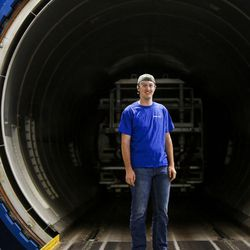 Ben Larsen, a senior at Davis High School and a member of the Utah Aerospace Pathways Program, stands next to an industrialized oven used for heating composites at the Orbital ATK manufacturing facility in Clearfield on Thursday, April 20, 2017.