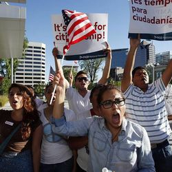Participants sing and chant during a prayer vigil in Salt Lake City, Thursday, June 27, 2013. At front is Wendoly Mendoza.