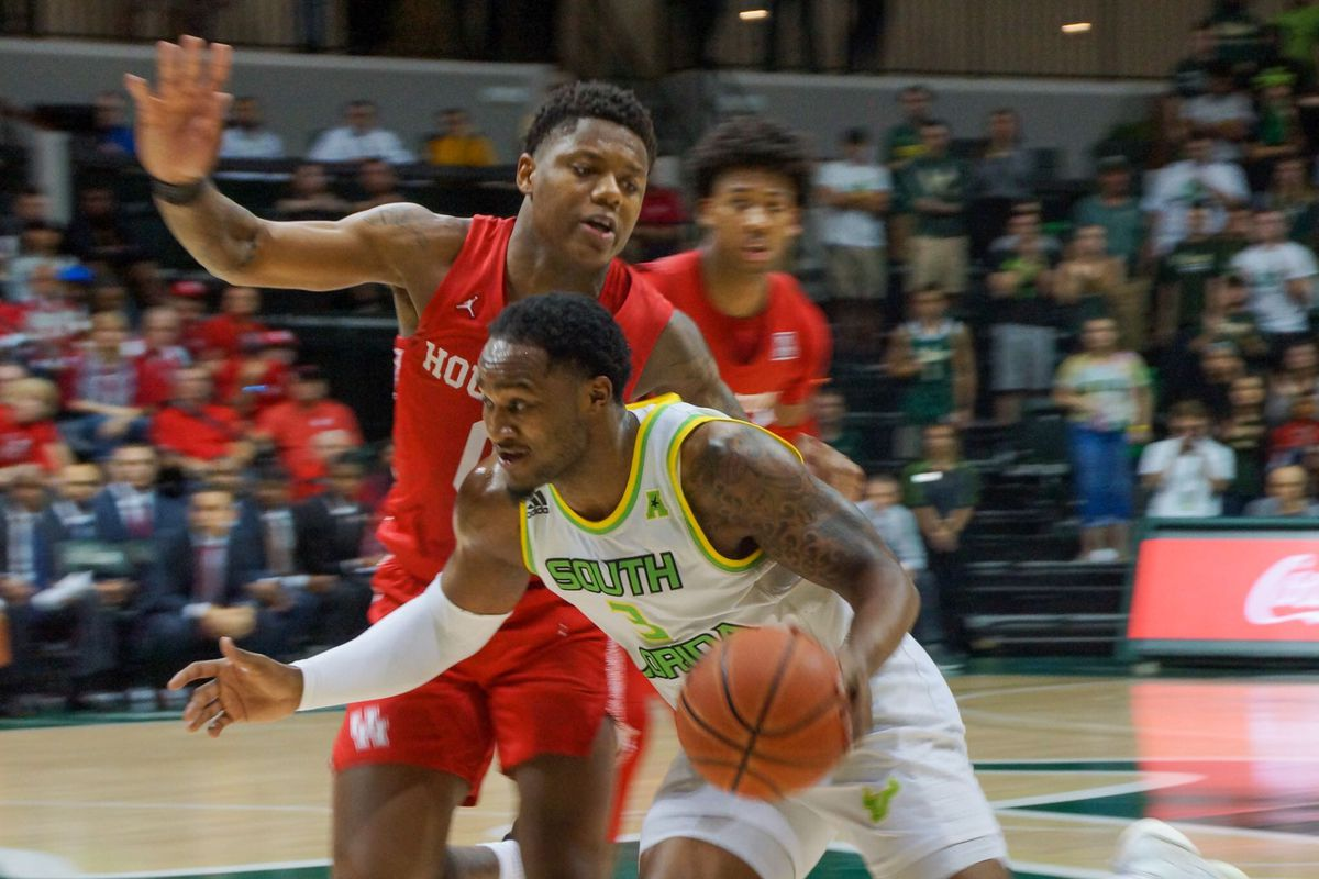 Laquincy Rideau of South Florida drives to the basket against No. 23 Houston on Wednesday February 12th at the Yuengling Center in Tampa.