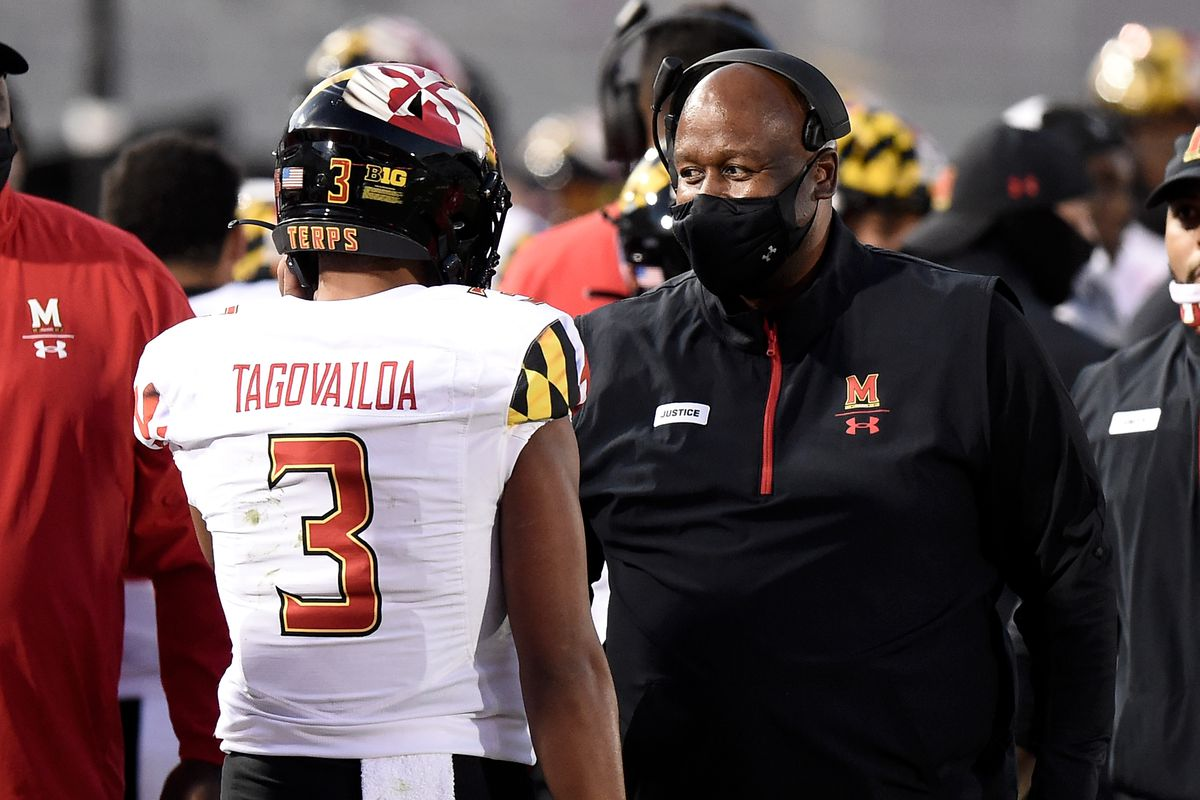 Head coach Michael Locksley of the Maryland Terrapins talks with Taulia Tagovailoa during the game against the Penn State Nittany Lions at Beaver Stadium on November 7, 2020 in State College, Pennsylvania.
