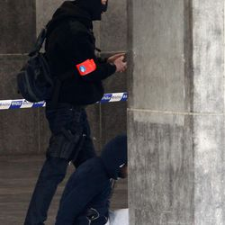 A Belgian police officer detains a man at the Gare du Midi train station in Brussels, Tuesday, March 22, 2016. Explosions, at least one likely caused by a suicide bomber, rocked the Brussels airport and its subway system Tuesday, prompting a lockdown of the Belgian capital and heightened security across Europe.