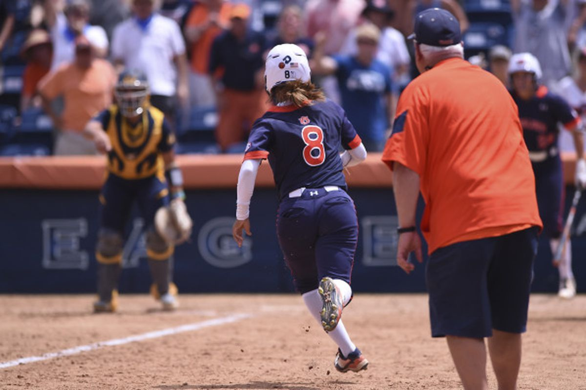 Brittany Maresette scores the winning run against Cal for Auburn Saturday afternoon.