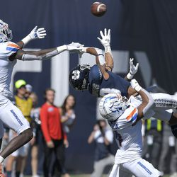 Boise State safety JL Skinner (0) and safety Rodney Robinson break up a pass intended for Utah State wide receiver Deven Thompkins (13) during the second half of an NCAA college football game Saturday, Sept. 25, 2021, in Logan, Utah.