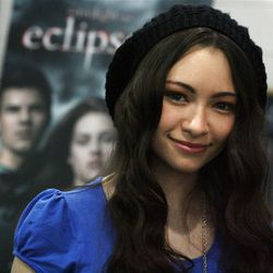 """Jodelle Ferland, best known as """"Bree Tanner"""" of the Twilight series, poses for a photograph with fans Elsie, center, and Chloe Hutchinson, at Best Buy. She was in Salt Lake City to sign copies of  """"Eclipse"""" and meet fans."""