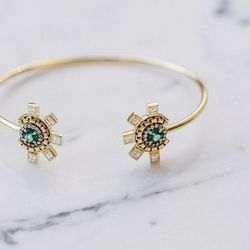 """<b>The Pick:</b> 18 karat gold, emerald and diamond 'Revival' cuff with chain and pavé detail, $10,500. See Jemma Wynne's <a href=""""http://jemmawynne.com/"""">website</a> for retailers."""