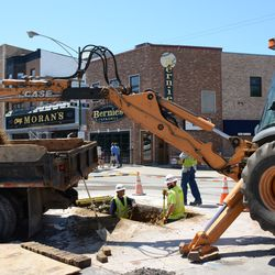 11:48 a.m. Utility work in the street at Waveland & Clark -