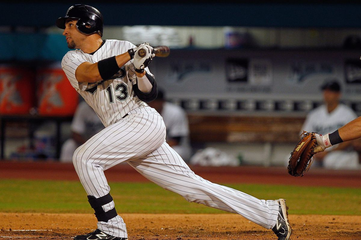 MIAMI GARDENS, FL - SEPTEMBER 26:  Omar Infante #13 of the Florida Marlins hits a triple during a game against the Washington Nationals  at Sun Life Stadium on September 26, 2011 in Miami Gardens, Florida.  (Photo by Mike Ehrmann/Getty Images)