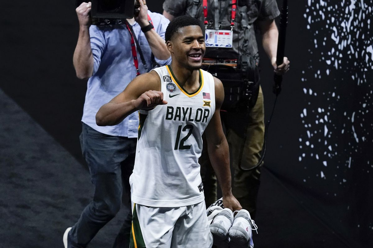 Baylor guard Jared Butler (12) celebrates as he walks off the court at the end of a men's Final Four NCAA college basketball tournament semifinal game against Houston