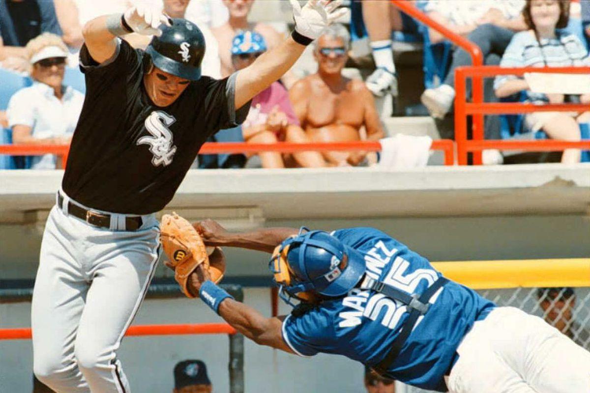 Toronto Blue Jays catcher Sandy Martinez (R) tries