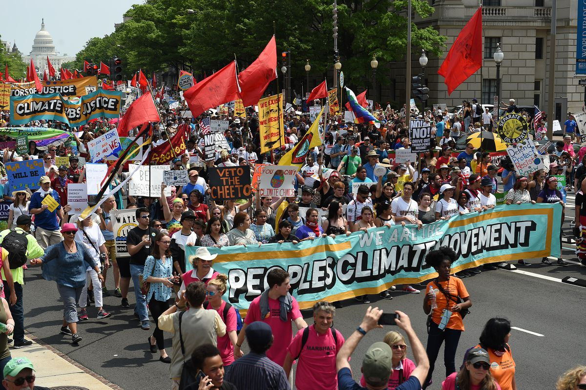 Demonstrators march in Washington, DC in 2017 demanding action on climate change. Polls show that Americans are more worried about climate change.