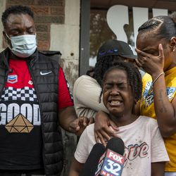 Zahana Hogan, 7, and niece to Verndell Smith, begins to cry whiles speaking with reporters at Ultimate Threat Dance Organization's studio, Thursday, May 20, 2021. Verndell, the founder of the dance studio was shot and killed yesterday.