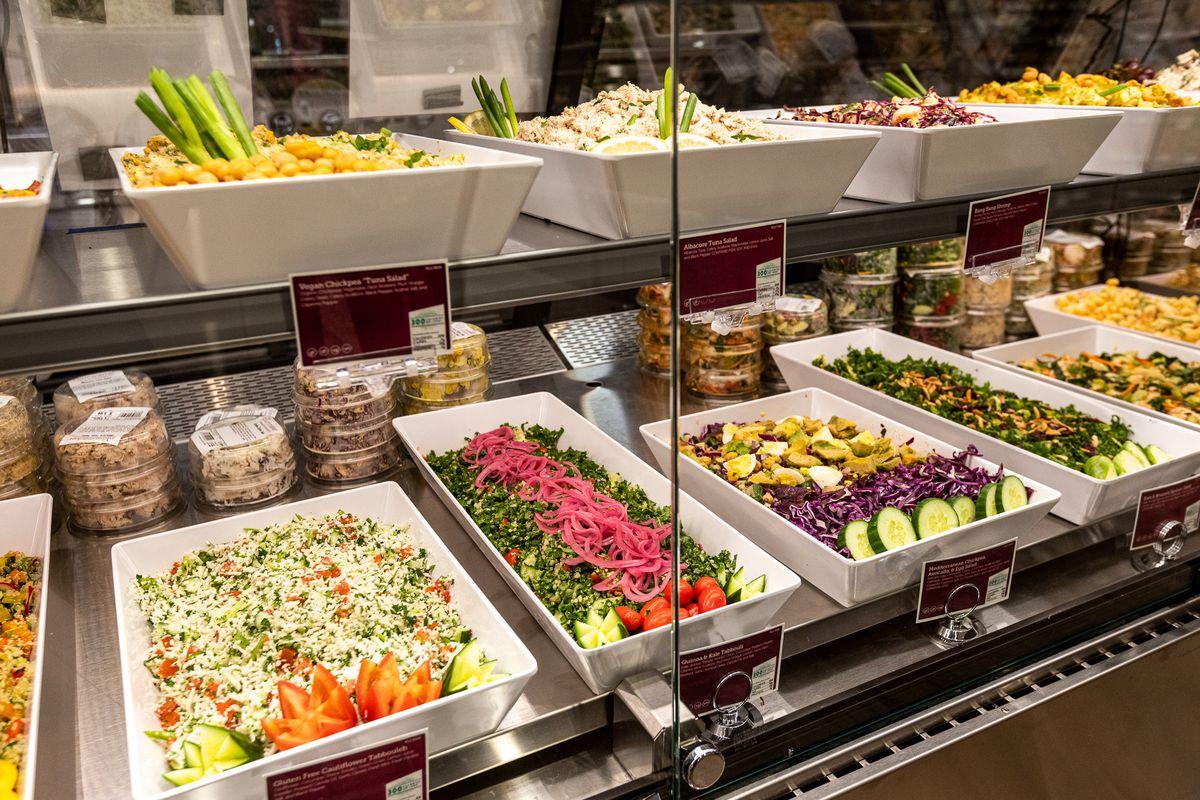 fresh, pre-fixed salads at the deli counter in plum market