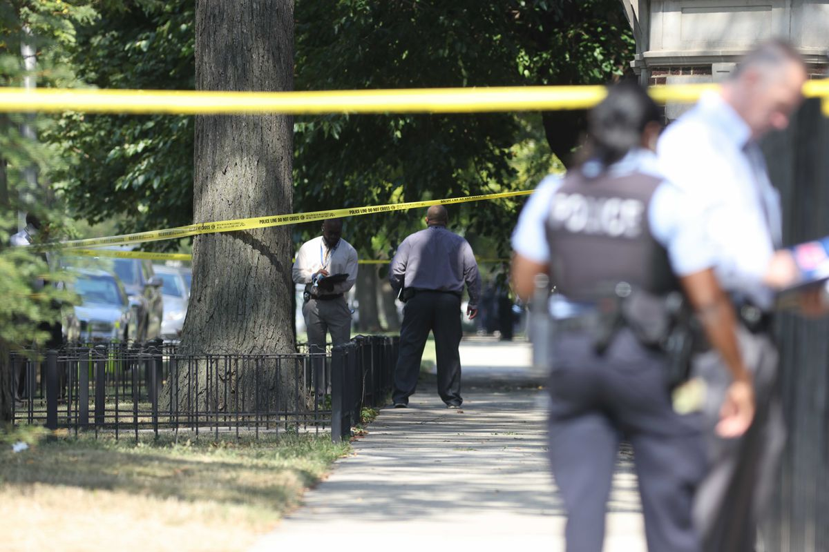Chicago police at the scene near 65th Street and Harvard Avenue in Englewood, where officers shot a person on Sunday, Sept. 19, 2021.