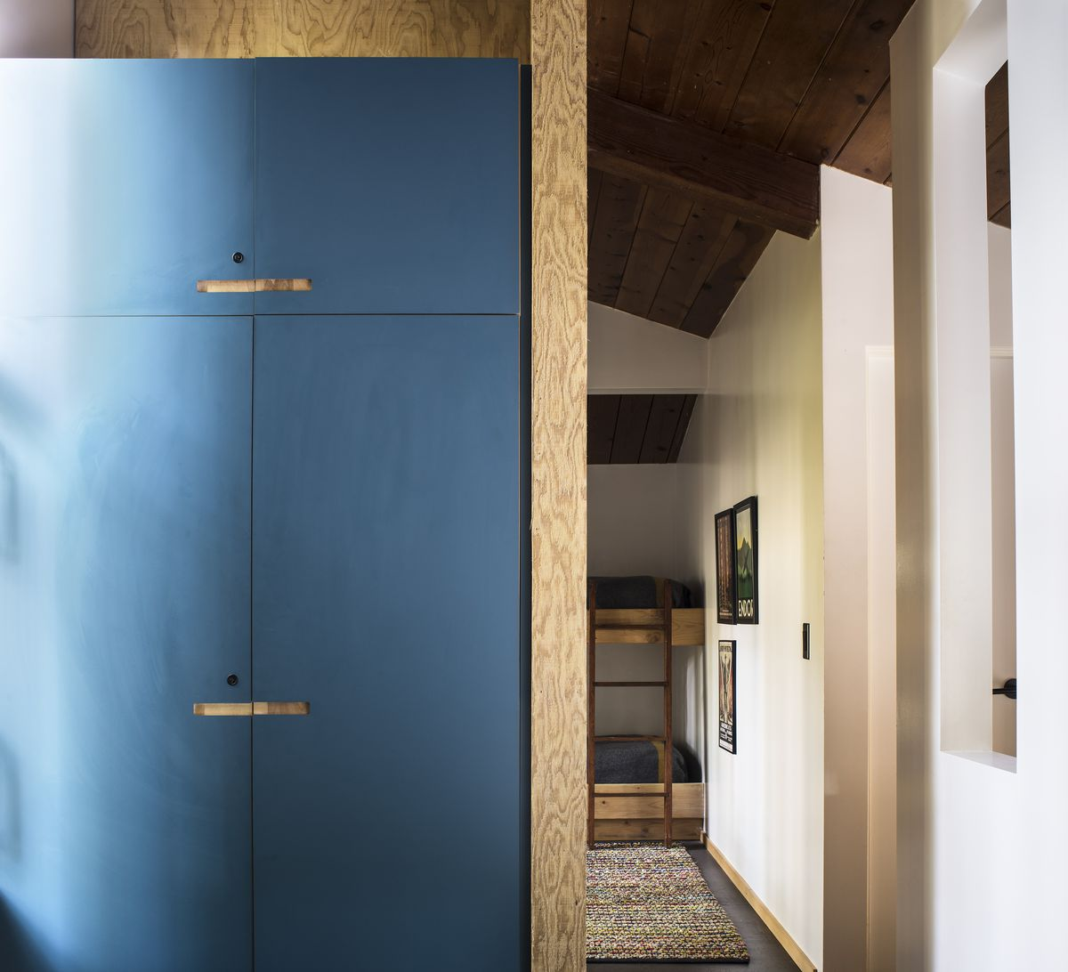 A closet has blue laminate doors.