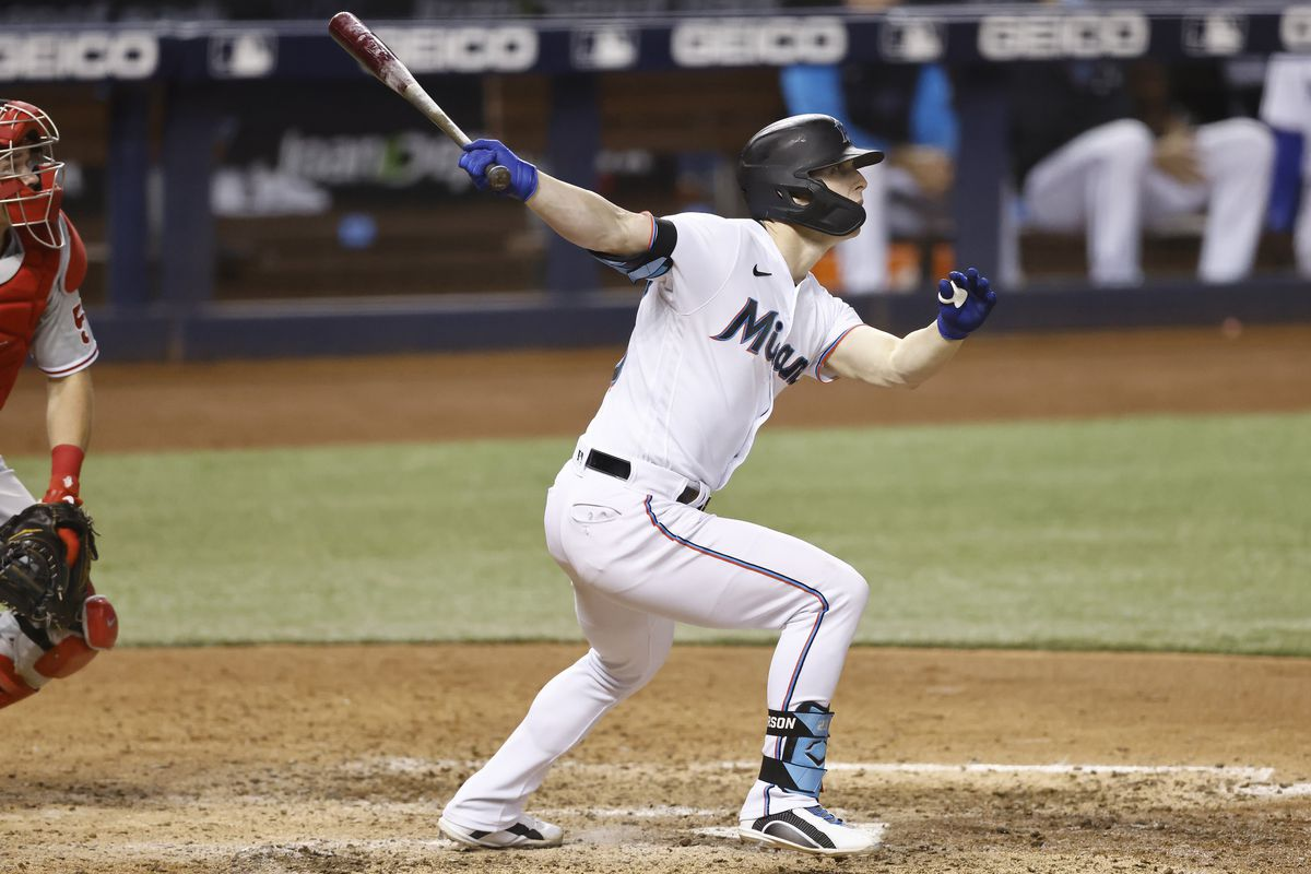 Corey Dickerson #23 of the Miami Marlins hits two-RBI triple during the sixth inning against the Philadelphia Phillies at loanDepot park