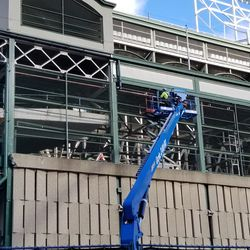 Another view of worker on south face of ballpark