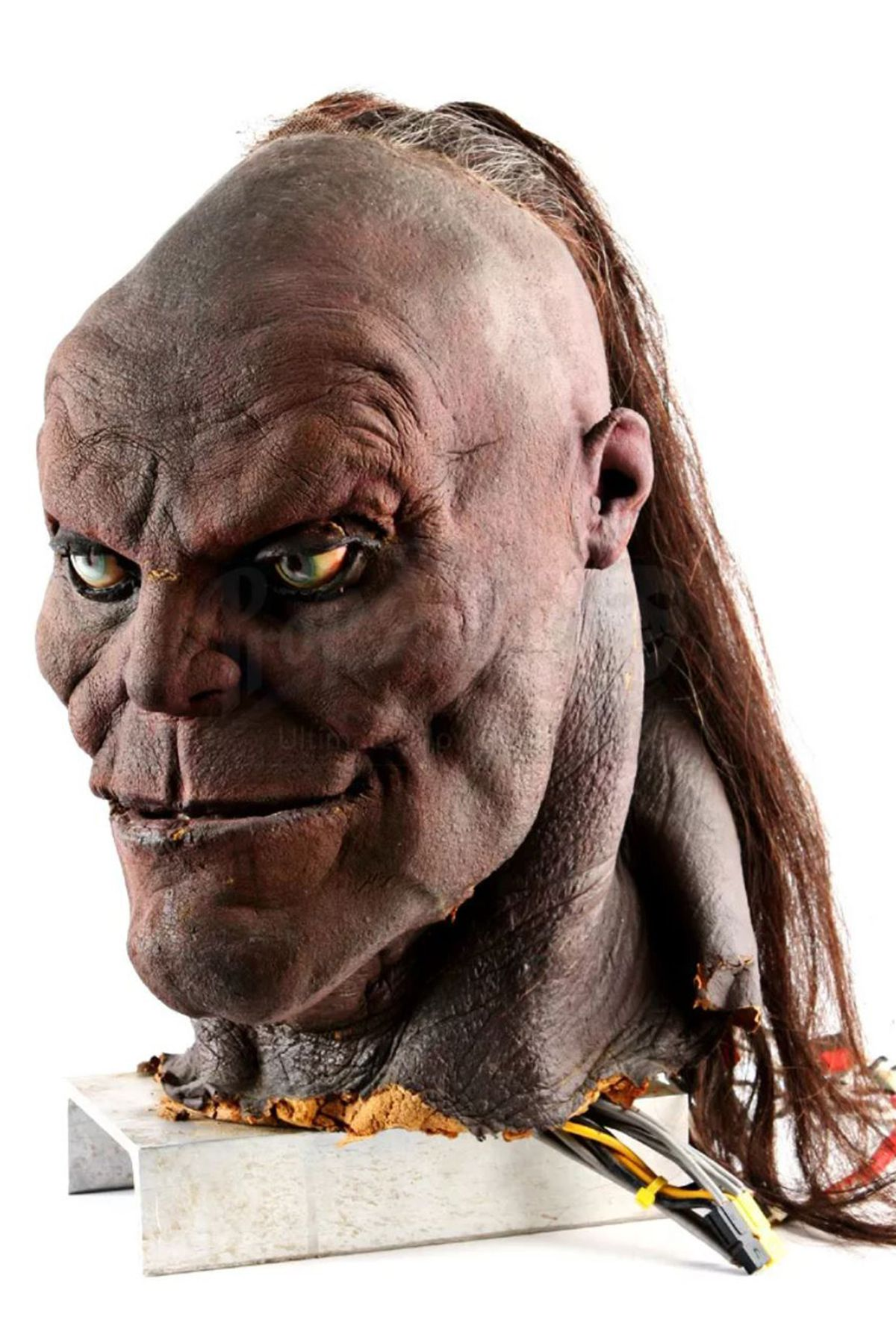 an angle shot of a prop of the head of Goro from Mortal Kombat