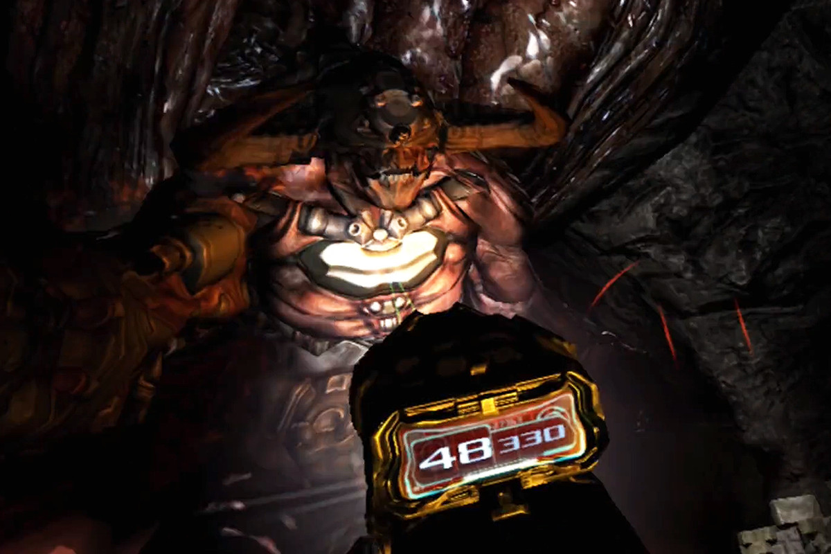 A giant looming demon with a gun and flashlight pointing at it from Doom 3 VR Edition.