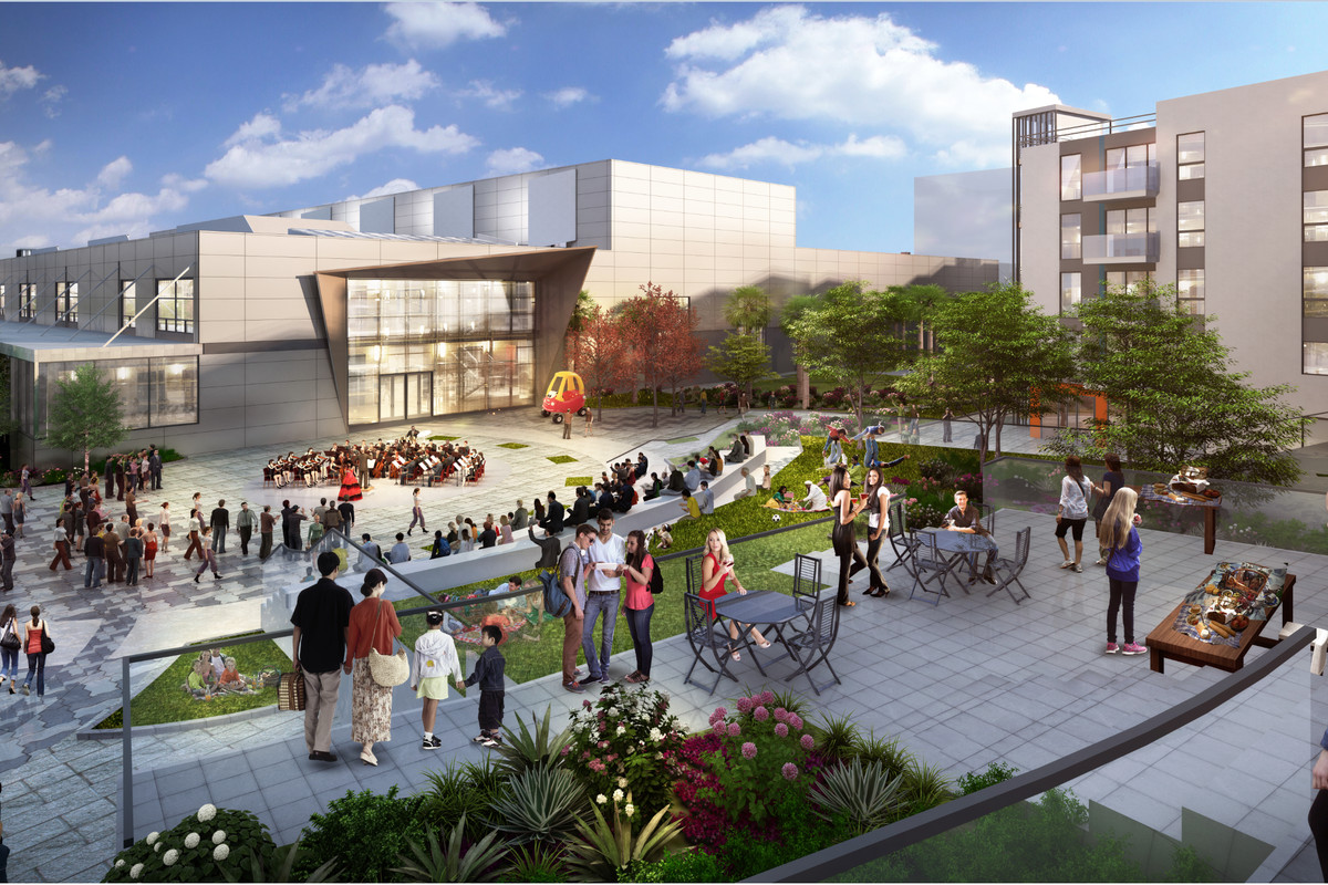 The amphitheater in the background of an outdoor area in the Uncommon 24 development.