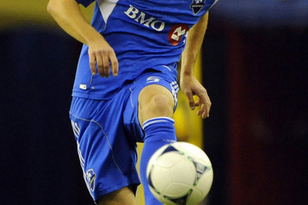 May 19, 2012; Montreal, QC, Canada; Montreal Impact defender Tyson Wahl (5) kicks the ball  during the first half of the game against the New York Red Bulls at the Olympic Stadium.  Mandatory Credit: Eric Bolte-US PRESSWIRE