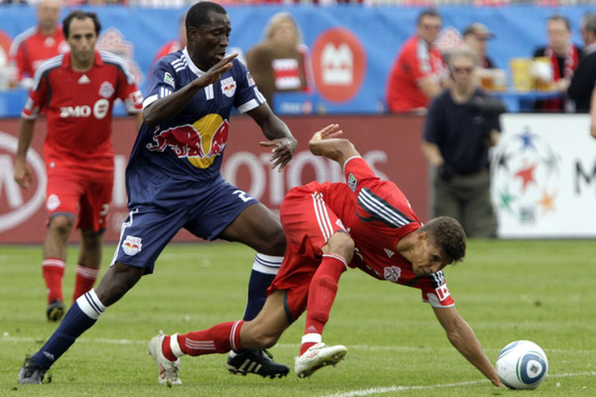 TORONTO - AUGUST 21: Adrian Cann #12 of Toronto FC battles for the ball with Salou Ibrahim #29 of the New York Red Bulls during a MLS game at BMO Field August 21 2010 in Toronto Ontario Canada. (Photo by Abelimages/Getty Images)