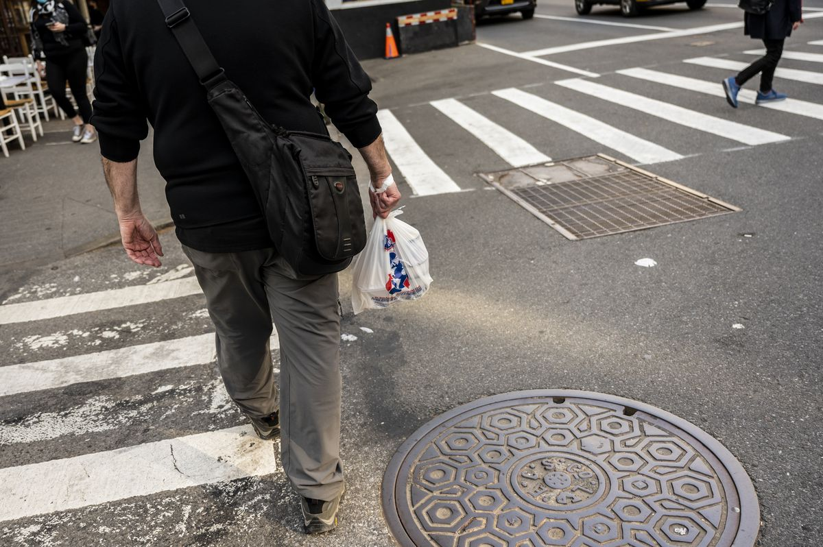 A Gristedes customer heads north on West 85th street.