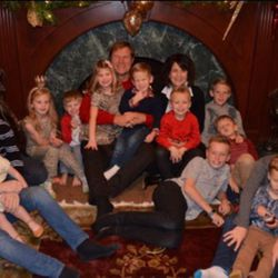 Mitch Olsen is photographed with his wife and grandchildren.