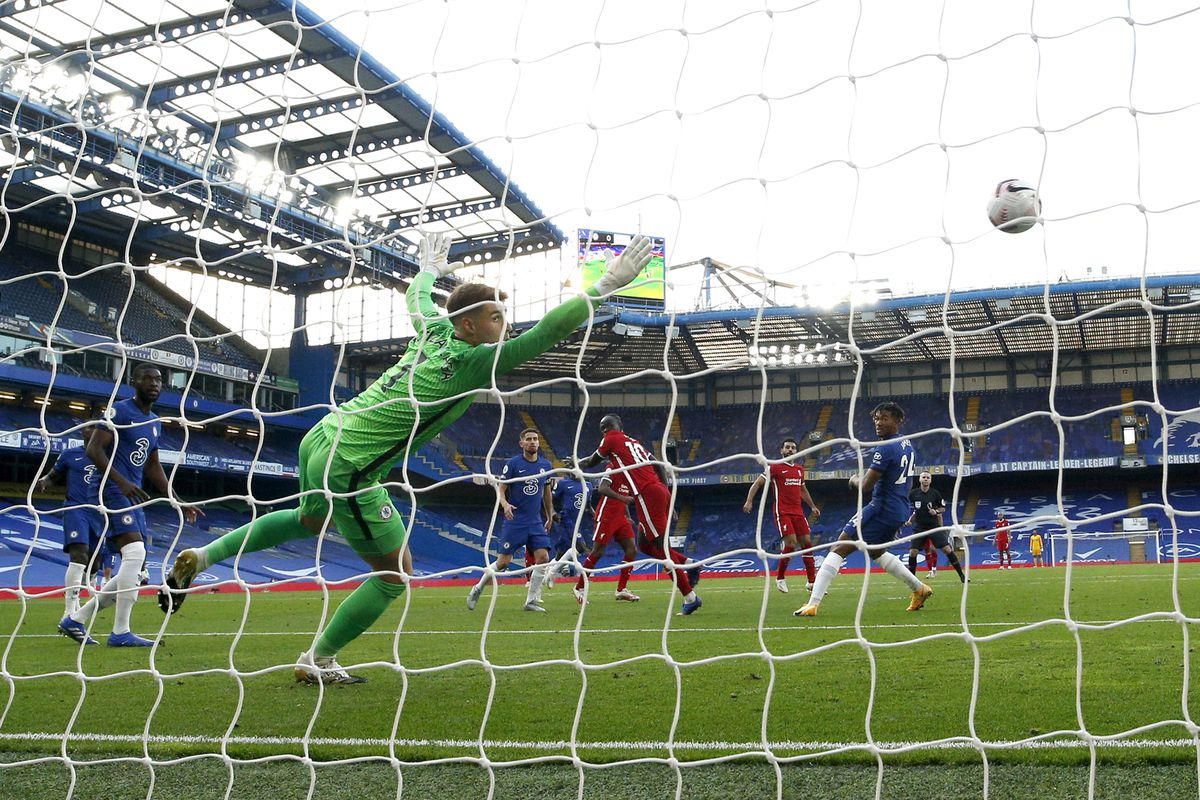 Sadio Mane of Liverpool scores his team's first goal during the Premier League match between Chelsea and Liverpool at Stamford Bridge on September 20, 2020
