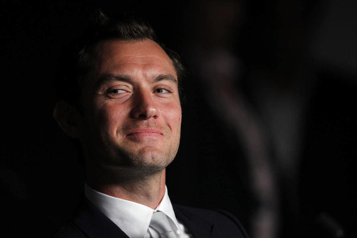 Jude Law looks on during a press conference of the jury, at the 64th international film festival, in Cannes, southern France, Wednesday, May 11, 2011.