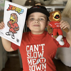 Young Ute fan Crew Frkovich shows off his coloring of Swoop, which was provided to the public by the University of Utah athletics department to fill the non-sports void.