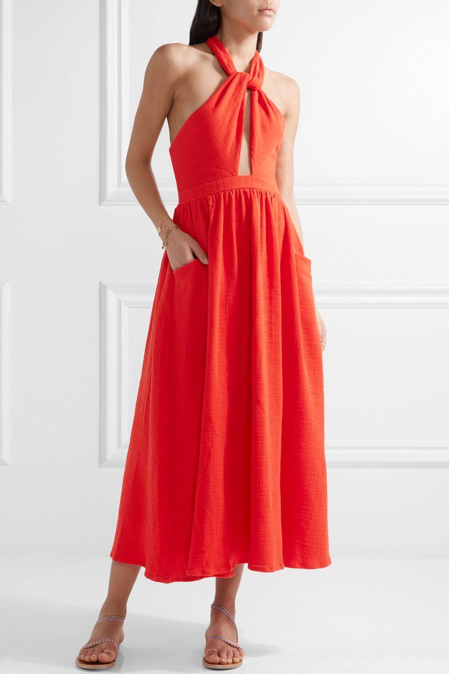 A model wearing a red dress