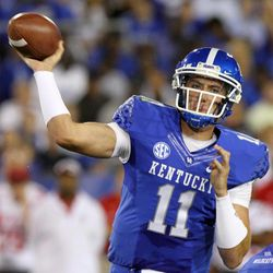 Kentucky's Maxwell Smith (11) looks for a receiver during the second quarter of an NCAA college football game against Western Kentucky at Commonwealth Stadium in Lexington, Ky., Saturday, Sept. 15, 2012.