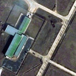 """This March 28, 2012 satellite image provided by DigitalGlobe shows a parked trailer and dish antenna, top right,  near the assembly building at North Korea's Tongchang-ri Launch Facility, on the nation's northwest coast. An analysis of images provided to The Associated Press by the U.S.-Korea Institute at Johns Hopkins School of Advanced International Studies shows Pyongyang """"has undertaken more extensive preparations for its planned April rocket launch than previously understood."""""""