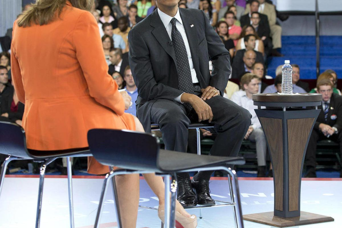 President Barack Obama participates in a town hall hosted by Univision and Univision news anchor Maria Elena Salinas, left, at the University of Miami, Thursday, Sept. 20, 2012, in Coral Gables, Fla.