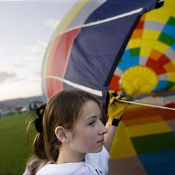 Lindsay Haupt of Springville assists in getting a hot air balloon flight ready at the Ogden Valley Balloon Festival held in Weber County on  Friday.